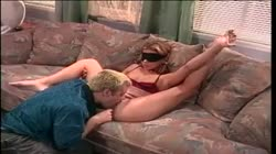 Blindfolded blonde spreads on a couch while dude licking and fingering her cunt